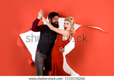 Happy couple enjoying dance. Stylish couple dancing. Romantic couple dance together at dance hall. Pretty woman and bearded man dancing. Dancing people in dance class. Cute young couple dancing.