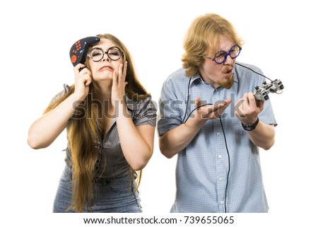 Happy couple enjoying leisure time by playing video games together. Studio shot isolated #739655065