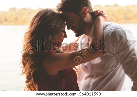 Stock Photo Happy couple face to face and Valentine's Day