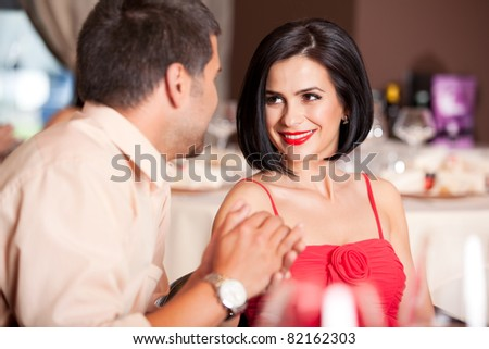 happy couple flirting at restaurant table