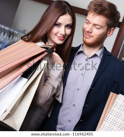 Happy couple goes shopping