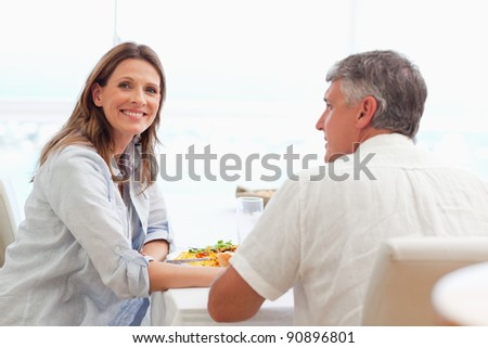 Happy couple having dinner together