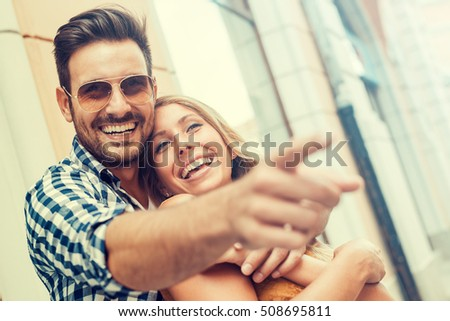 Happy couple having fun on a sunny day in the city. #508695811