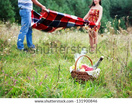 Happy Couple Having Romantic Picnic Together Outside