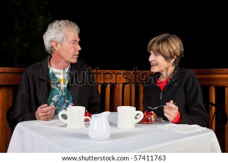 Happy Couple Having Strawberry Cake and Coffee at an Outdoor Restaurant.