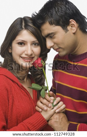 Happy couple holding a flower