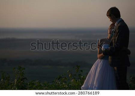happy couple hugging  background skyline - Shutterstock ID 280766189