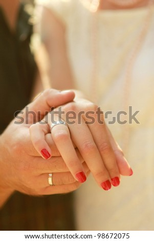 Happy couple  II Close-up photo of a caucasian couple's hands on their wedding day.