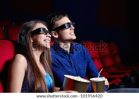 Happy couple in a movie theater