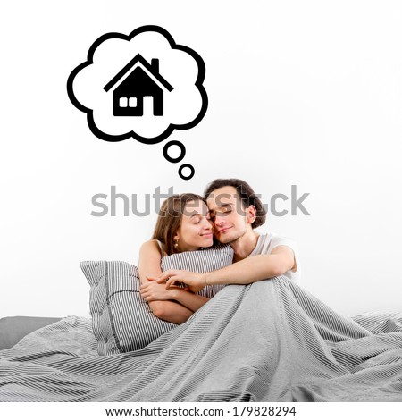 Happy couple in bed thinking and dreaming about house on white background