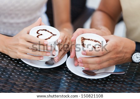 Happy couple in love drinking coffee