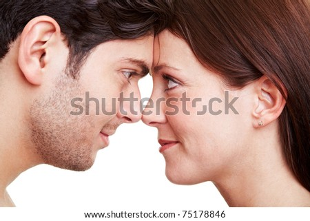 Happy couple in love looking deeply into each others eyes