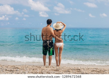 Happy couple in love on beach summer vacations. Sea vacation concept