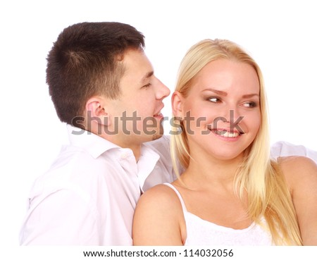 Happy couple in love on white background. Man whisper a compliment.