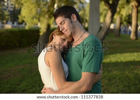 happy couple in love outdoors hugging