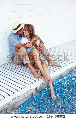 Happy couple in love posing outdoor in shabby chic interior and having fun. White background.