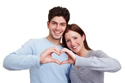 Happy couple in love showing heart with their fingers