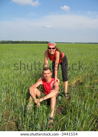 happy couple in the wheat