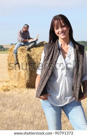 happy couple in their farm