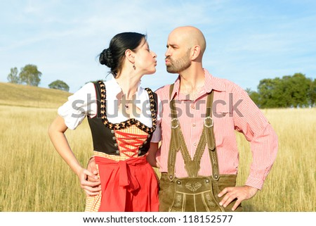 happy couple in traditional bavarian garbs