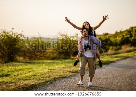 Happy couple is hiking in mountain. They are having fun in nature. ストックフォト ©