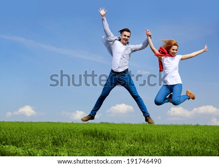 Happy couple jumping. Freedom concept. Free. Jumping People. Fun