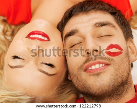 happy couple lying at home with closed eyes (focus on woman)