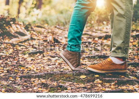 Happy Couple Man and Woman Feet in Love Romantic Outdoor Lifestyle with Autumn nature on background Lifestyle Fashion trendy style