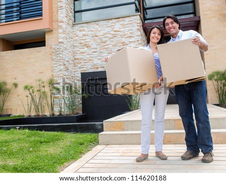 Happy couple moving into a new house