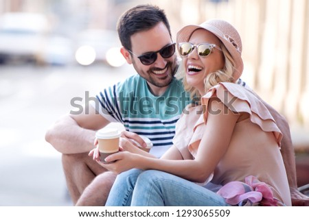 Happy couple of tourists on vacation having fun together. #1293065509