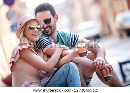 Happy couple of tourists on vacation having fun together. #1293065512