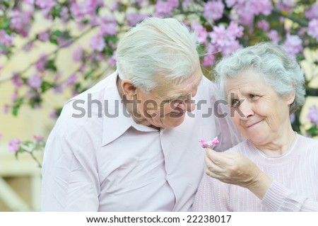 happy couple old people on spring background - stock photo