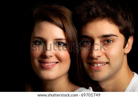 Happy couple on a dark background - stock photo