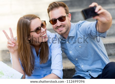 Happy couple on holidays taking a picture