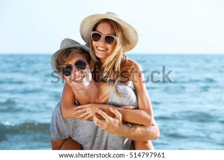 Happy couple on sea background