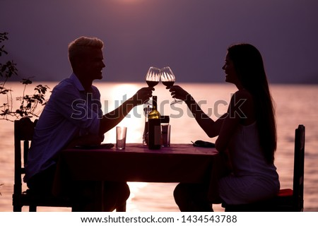 Happy couple on summer evening having romantic dinner outdoor #1434543788