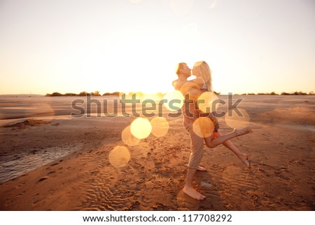 happy couple on the beach - stock photo