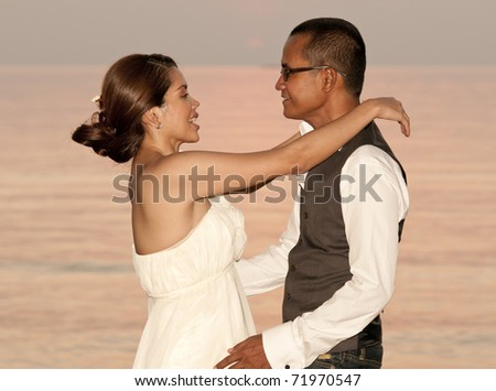 Happy couple on the beach after wedding