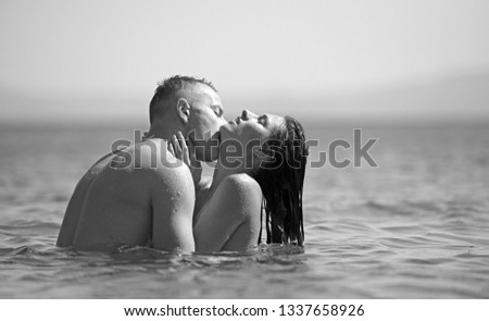 happy couple on the beach kissing in water #1337658926