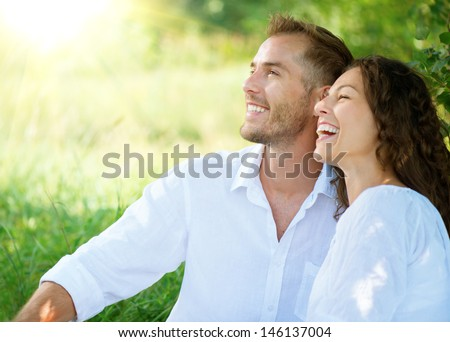 stock photo happy couple outdoor smiling couple relaxing in a park family over nature green background 146137004