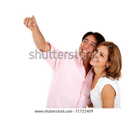Happy couple pointing at something - isolated over white
