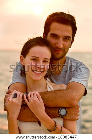 happy couple portrait at sunset in a romantic setting