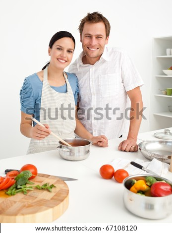 Happy couple preparing a bolognese sauce together