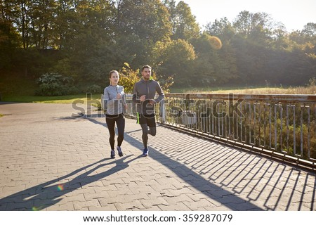 happy couple running outdoors #359287079