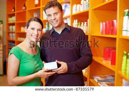 Happy couple shopping for medication in a pharmacy
