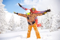 Happy couple skier and snowboarder are having fun at ski resort. Ski winter sports concept