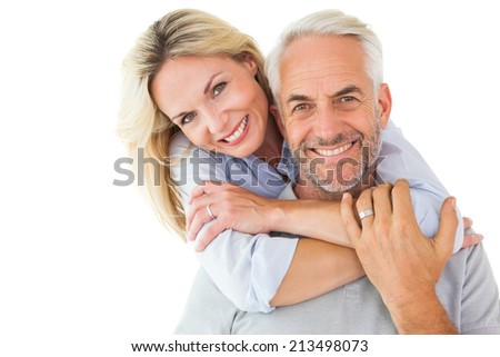 Happy couple standing and hugging on white background