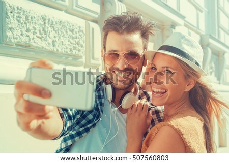 Happy couple taking a selfie.They are enjoying together in the city. #507560803