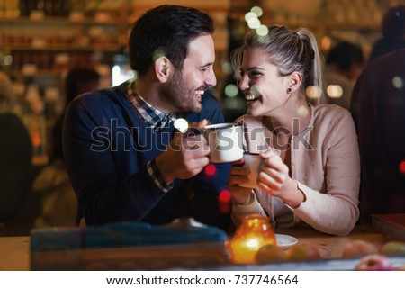 Happy couple talking at bar and having date #737746564