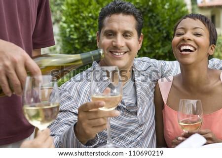 Happy couple tasting wine